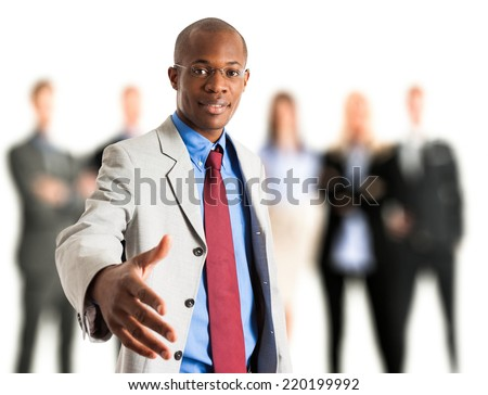 Smiling businessman giving an handshake - stock photo