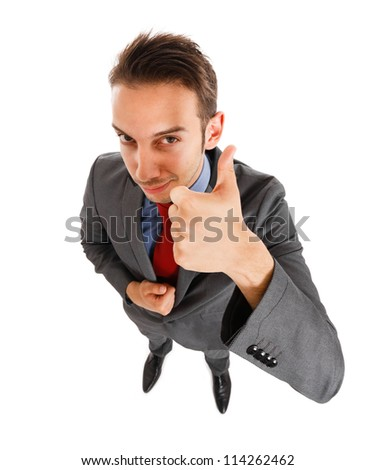 Smiling businessman giving thumbs up - stock photo