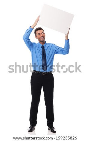 Smiling businessman holding blank placard - stock photo