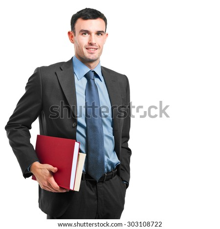Smiling businessman holding books on white background - stock photo