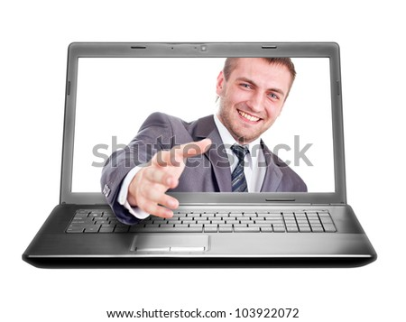 Smiling businessman is going to handshake from laptop. Isolated on white - stock photo