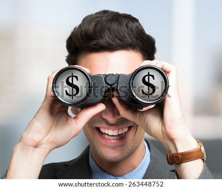 Smiling businessman looking to a Dollar symbol through binoculars - stock photo