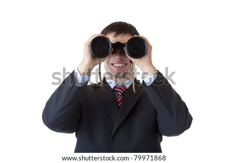 Smiling businessman looks through binoculars and espies business.Isolated on white background - stock photo
