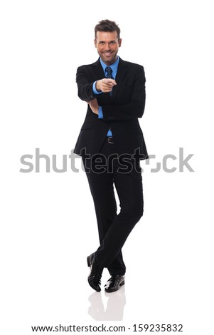 Smiling businessman pointing at camera side  - stock photo