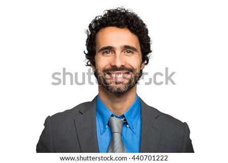 Smiling businessman portrait on white background - stock photo