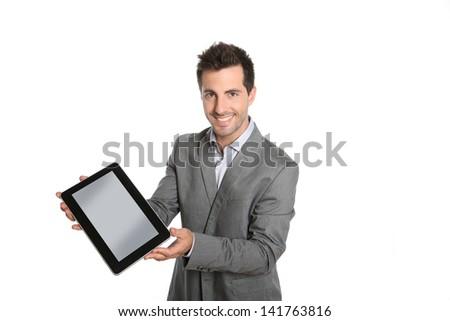Smiling businessman presenting website on tablet - stock photo