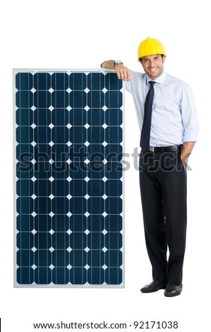 Smiling businessman showing a solar panel, symbol of green energy and good environmental business