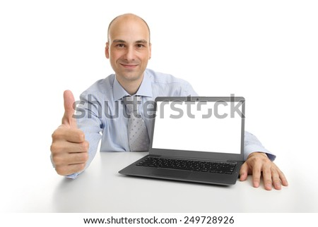 Smiling businessman showing laptop computer with blank screen - stock photo