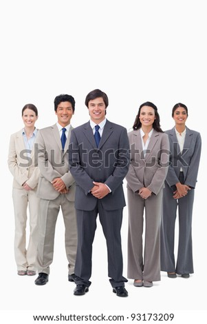 Smiling businessman standing with his team against a white background