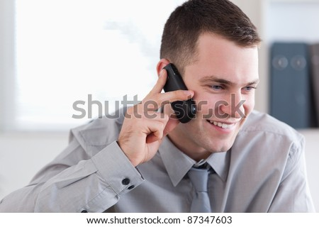Smiling businessman talking on the cellphone