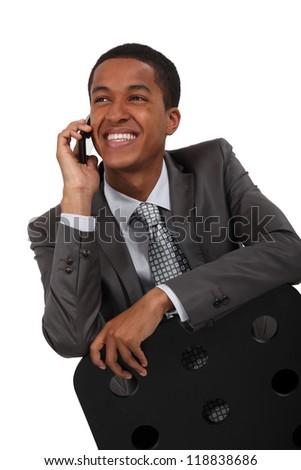 Smiling businessman talking on the phone - stock photo