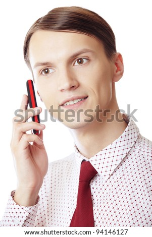 Smiling businessman talking via cell phone on a white background - stock photo
