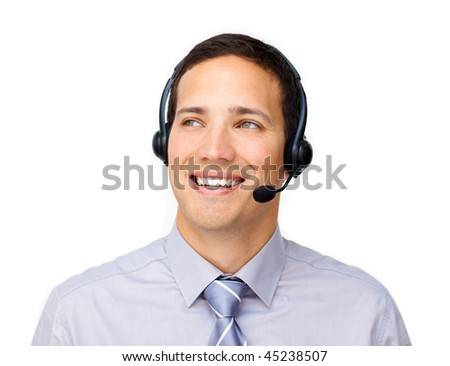 Smiling businessman talking with a headset against a white background - stock photo