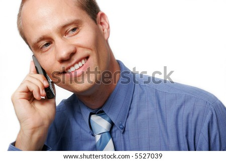 Smiling businessman using his mobile phone, against a white background. - stock photo