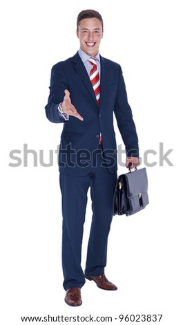 Smiling businessman with a briefcase offering a deal
