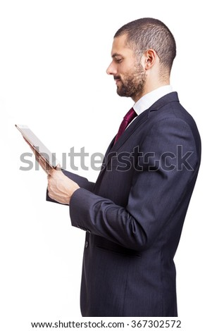 Smiling businessman with digital tablet on white background
