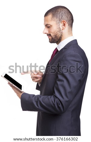 Smiling businessman with digital tablet on white background - stock photo
