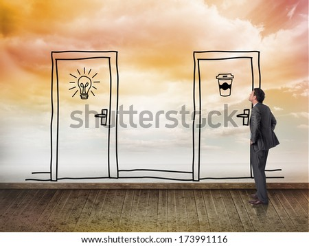 Smiling businessman with hands on hips against two doors on wall with bright sky