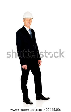 Smiling businessman with hard hat - stock photo