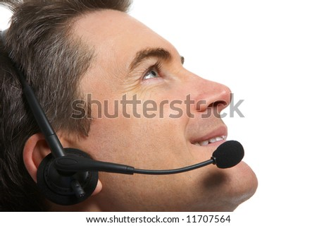 Smiling  businessman  with headsets. Over white background