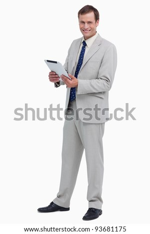Smiling businessman with his tablet computer against a white background - stock photo