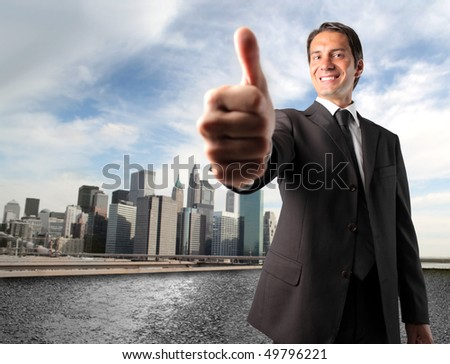 Smiling businessman with thumbs up - stock photo