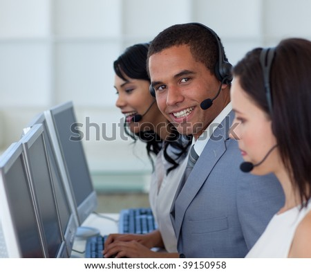Smiling businessman working in a call canter