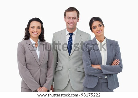 Smiling businessteam standin against a white background - stock photo