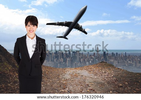 Smiling businesswoman against large city on the horizon