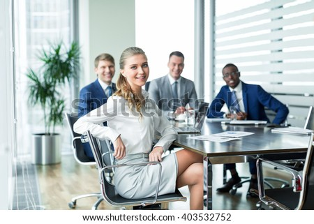 Smiling businesswoman at meeting  - stock photo