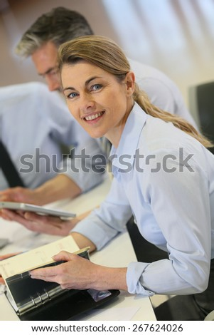 Smiling businesswoman attending work meeting