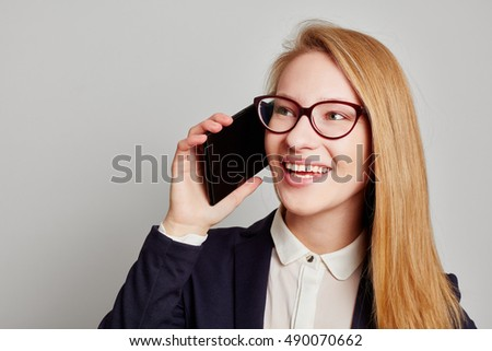 Smiling businesswoman calling with her smartphone