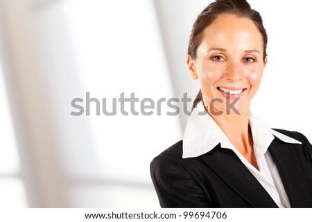 smiling businesswoman closeup portrait on white - stock photo