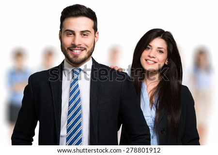 Smiling businesswoman congratulating with a colleague of her - stock photo