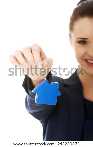 Smiling businesswoman holding a keychain - stock photo