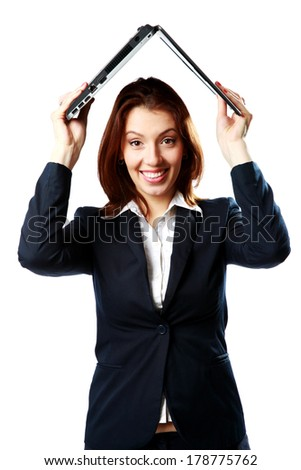 Smiling businesswoman holding a laptop above her head like a roof isolated on a white background - stock photo