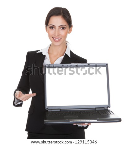 Smiling Businesswoman Holding Laptop. Isolated On White - stock photo