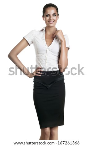 smiling businesswoman in skirt on white background - stock photo