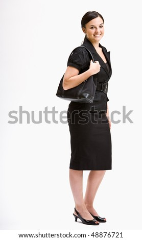 Smiling businesswoman in suit - stock photo