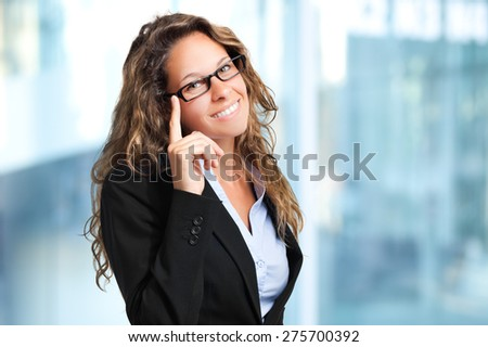 Smiling businesswoman in the office - stock photo