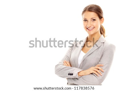 Smiling businesswoman looking at camera in isolation - stock photo