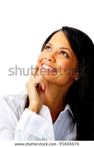 Smiling businesswoman looking up - stock photo