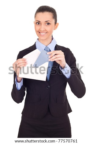 smiling businesswoman sending mail, looking at camera, isolated - stock photo