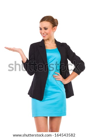 Smiling businesswoman showing product. Three quarter length studio shot isolated on white.