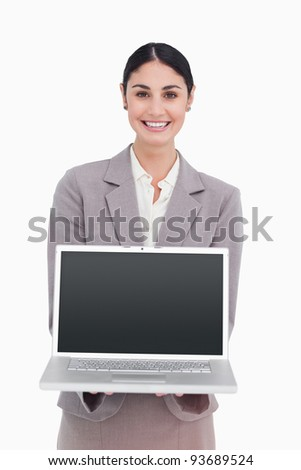Smiling businesswoman showing screen of her laptop against a white background