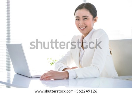 Smiling businesswoman sitting at her desk in work