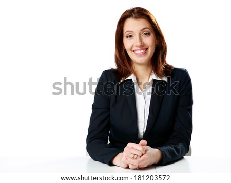 Smiling businesswoman sitting at the table isolated on a white background - stock photo