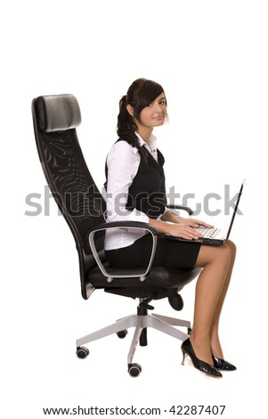 smiling businesswoman sitting on the office chair with laptop - stock photo