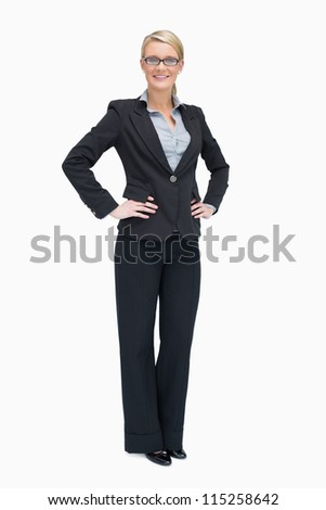 Smiling businesswoman standing her hands on the hip