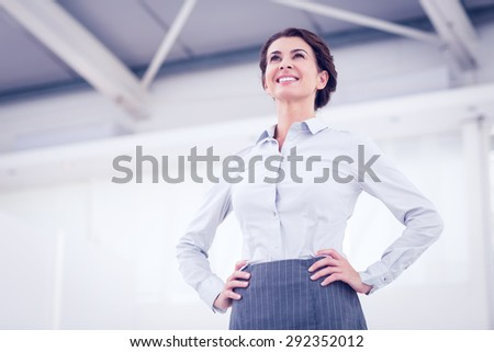 Smiling businesswoman standing in the office - stock photo